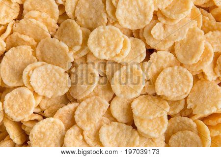 Cornflakes background. Crispy corn flakes for breakfast.