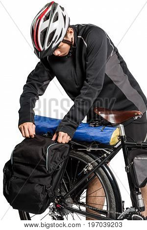 Portrait Of An Asian Man Cyclist With Helmet And Sportswear Packing Bag Of Touring Bicycle. Isolated