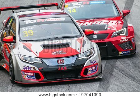 Bang Saen Thailand - July 1 2017: WS Lai Malaysia and Pasarit P. seat Thailand fighting for positions during TCR Asia Series at Bang Saen Street Circuit in Bang Saen Thailand.