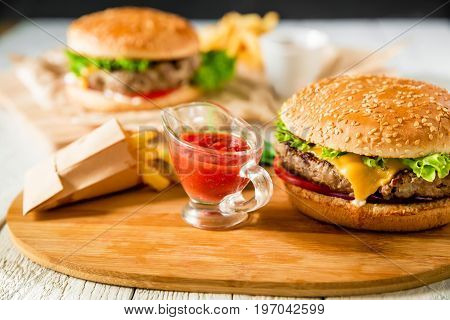 Classic american hamburger with tasty beef, sauce and french fries