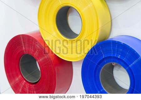The cord of red blue and yellow plastic strip