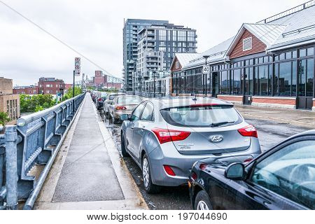 Montreal, Canada - May 26, 2017: Parked Cars On Road Or Street In Quebec Region During Rainy Cloudy