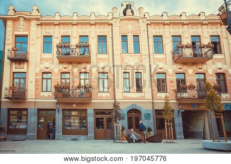 TBILISI, GEORGIA - OCT 10, 2016: Some relaxing people on reconstructed street David Agmashenebeli with historical houses on October 10, 2016. Tbilisi has a population of 1.5 million people