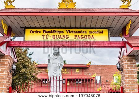 Montreal Canada - May 26 2017: Buddhist Temple entrance and Tu Quang Pagoda sign in city in Quebec region during wet rain on cloudy day
