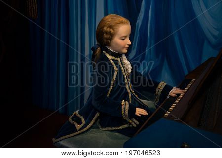 Prague, Czech republic, July 22, 2017: Little Wolfgang Amadeus Mozart in Grevin museum of the wax figures in Prague.