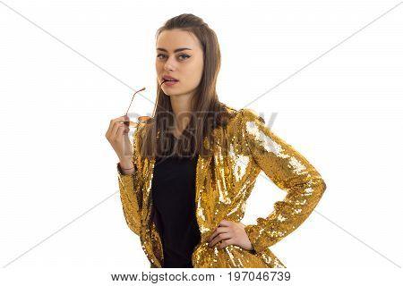 Beautiful lady in golden jacket posing on camera isolated on white background