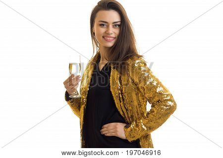 Cheerful lady in golden jacket with wine smiles isolated on white background