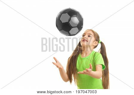 Cheerful little girl plays with ball in studio isolated on white background