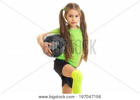 Pretty little girl with ball in studio isolated on white background