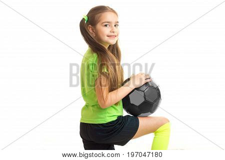 Cutie little girl with ball in studio isolated on white background