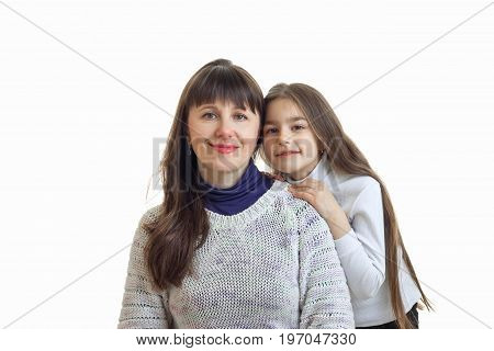 Couple of mother with her daughter hugs and smiles on camera isolated on white background