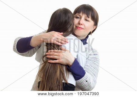 Adult mother hugs her little daughter isolated on white background