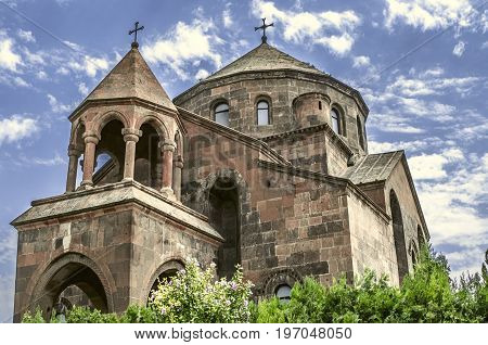 View of the umbrella-shaped roof with a cross and rotunda with columns on the church great martyr St. Hripsime
