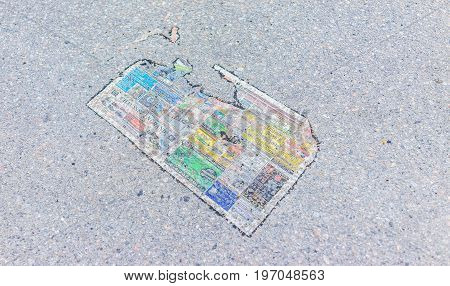 Montreal, Canada - May 26, 2017: Wet Colorful Newspaper On Ground In City In Quebec Region On Asphal