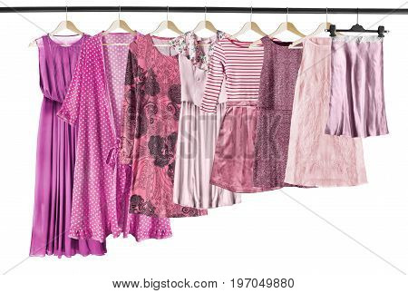 Pink woman clothes on clothes rack isolated over white