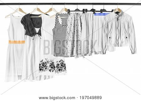 White and black woman clothes on clothes racks isolated over white