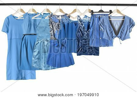 Set of blue woman clothes on clothes racks on white background