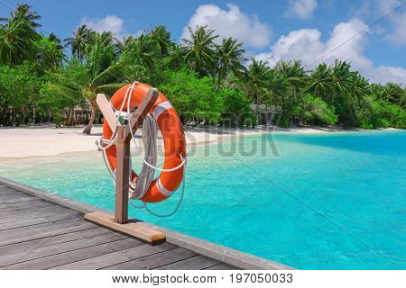 Wooden pontoon with flotation ring at tropical resort