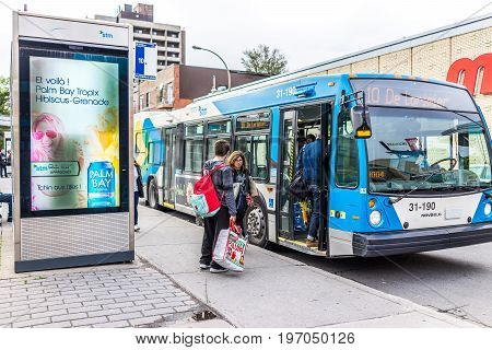 Montreal, Canada - May 26, 2017: Novabus Bus In City In Quebec Region With People Getting On