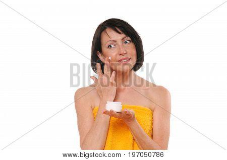 Portrait Of Pretty Mature Woman Using Face Cream