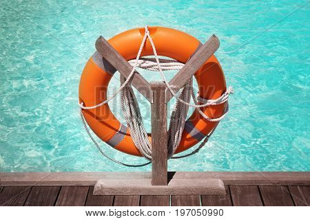 Wooden pontoon with flotation ring at sea resort