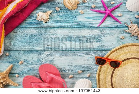 High angle view of summer vacation beach accessories on blue wooden background with copy space