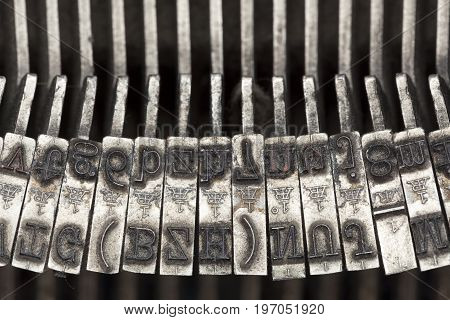 Closeup of the letters of a vintage mechanical typewriter
