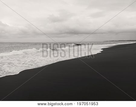 Amed beach, Bali, Indonesia - July 2017: The beach with black volcanic sand