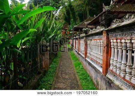 Tirta Gangga, Karangasem, Bali, Indonesia - July 2017: The road to the centre of the soul