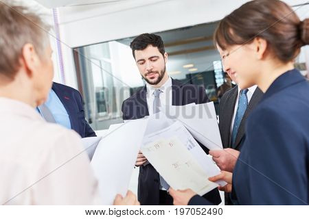 Business team in meeting with documents for strategy planning