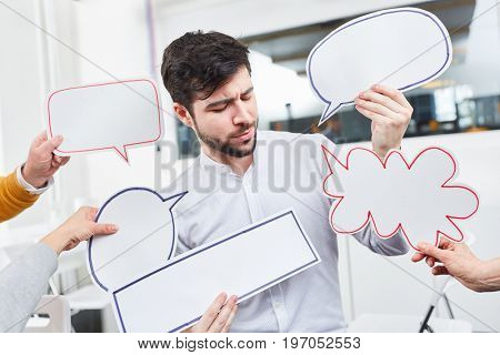 Man with speech bubbles for ideas and communication