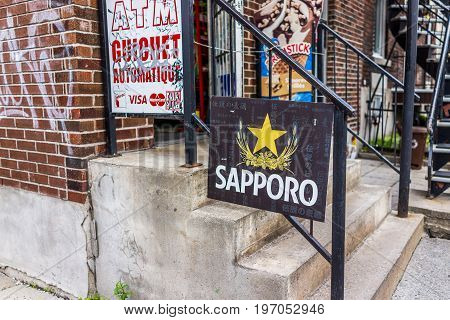Montreal, Canada - May 27, 2017: Sapporo Japanese Sign By Liquor Store In Plateau Neighborhood In Ci