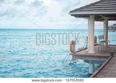View of sea and shelter shed at resort on summer day