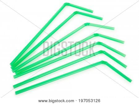Green drinking straws on white background