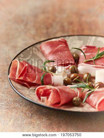 Mediterranean cured ham with olives