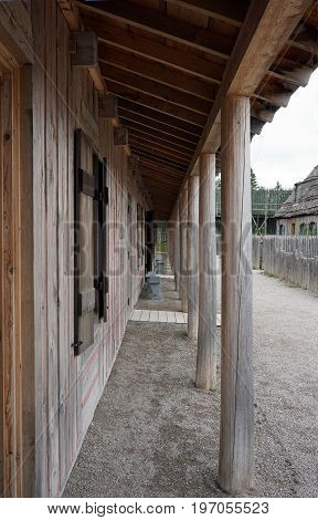 Eaves provide shelter in front of a longhouse in Fort Michilimackinac, in the Colonial Michilimackinac State Park in Mackinaw City, Michigan.