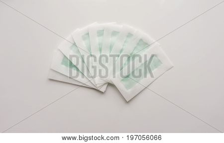 Hair depilation wax strips on a white background. Top. Close-up. Stock photo.