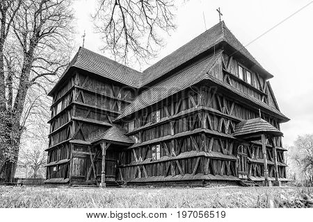 Articular wooden church in village Hronsek Slovakia. Black and white photo