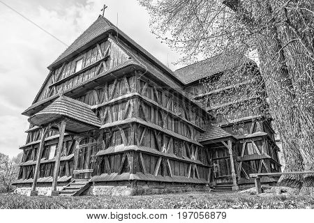 Articular wooden church in village Hronsek Slovakia. Black and white photography