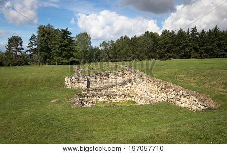 Lidice, Czech Republic - July 21, 2017: Lidice war memorial park, Czech Republic. Foundations of Horak's estate, the only remains of the village destroyed completely by Nazis in June 1942