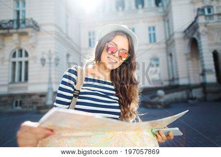 Cute Tourist Girl At European City Background