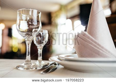Photo Of Glasses, Napkins And Cutlery On The Table