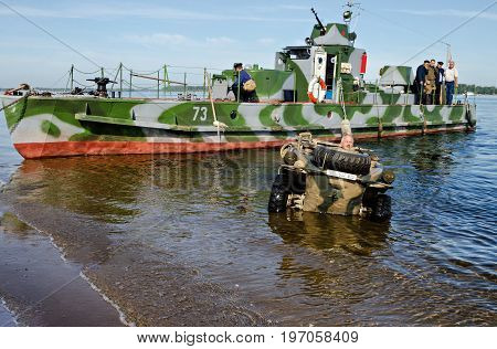 Historical festival of the Second World war to Samara, July 26, 2015. The Soviet landing craft and German floating car on the Volga river, before reconstruction.