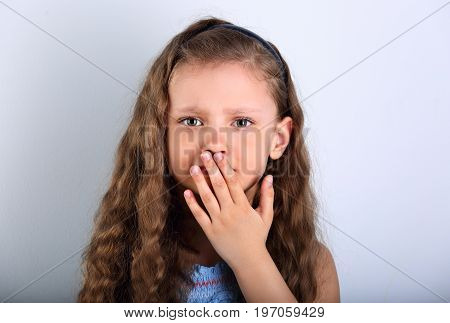 Unhappy Afraid Emotional Small Kid Girl With Teeth Pain Covering Hand The Mouth. Closeup Portrait On