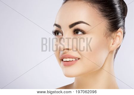 Beautiful Girl With Nude Make Up At Studio Background