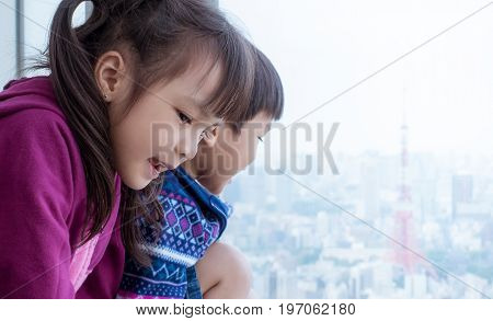 Siblings is looking out to Tokyo city from windows