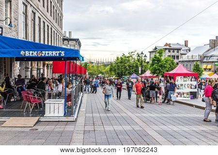 Montreal, Canada - May 27, 2017: Old Town Area With People Walking Up Street In Evening Outside Ben