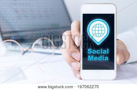 Business man is holding blank screen phone for mock up