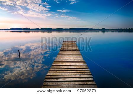 Empty footbridge over the lake Selment Wielki. Masuria Poland.