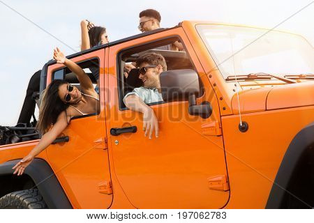 Happy friends having a good time on a road trip together